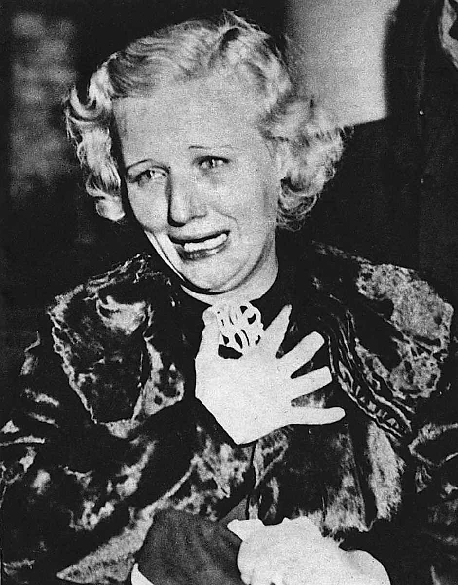 a crime scene photograph by Weegee (Arthur Fellig), an upset woman crying