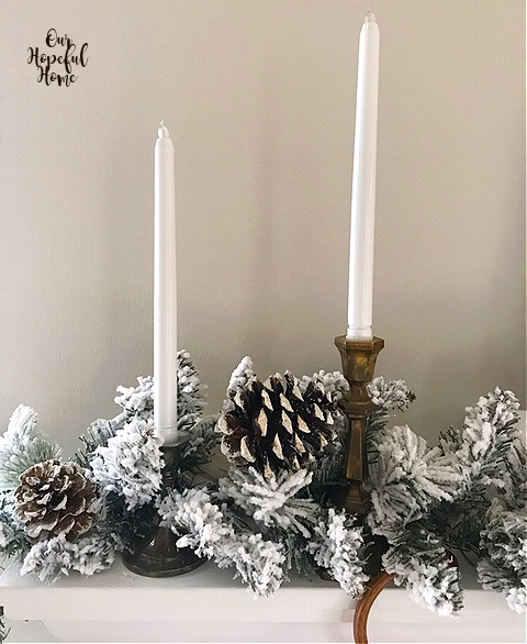 white LED taper candles pine cones flocked garland mantel