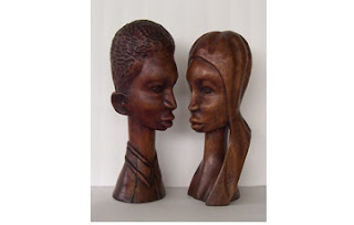 Wood Sculptures of a Young Black Couple