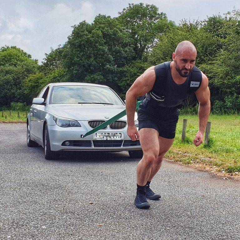 This Man Did 26.2 Miles Pulling a Car. Here's How He Trained