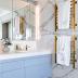 Banheiro branco e cinza com porcelanato marmorizado e metais dourados!