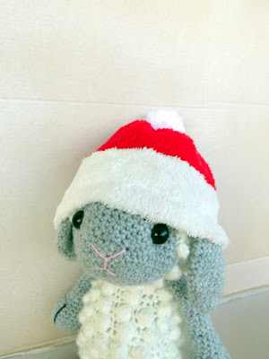 crochet amigurumi sheep with santa hat