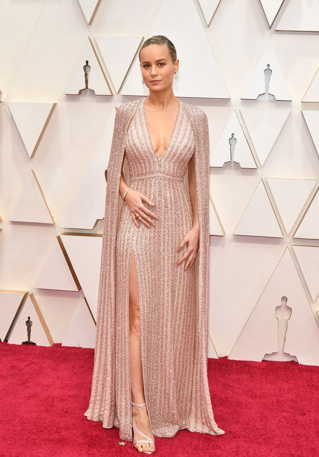 Brie Larson takes the plunge in pink sparkly caped Celine gown to present at the Academy Awards