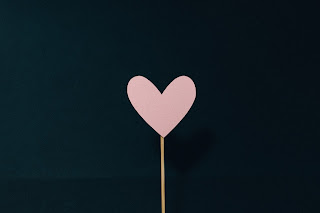 Pink heart on a stick