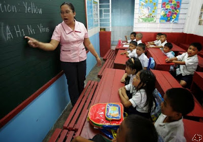 Filipino teacher teaching students