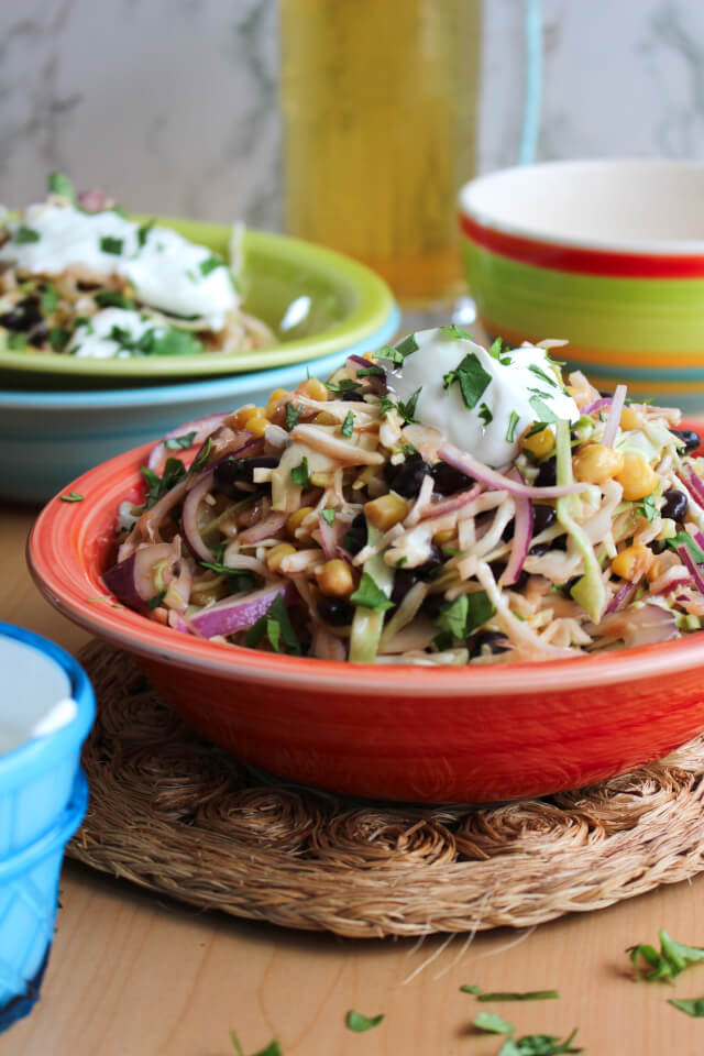 Mexican Slaw is a light and healthy tex-mex twist on traditional coleslaw that is great served as a side dish or as a taco topper!  #feastndevour