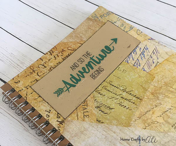 Keep track of your travel adventures with this easy DIY notebook!