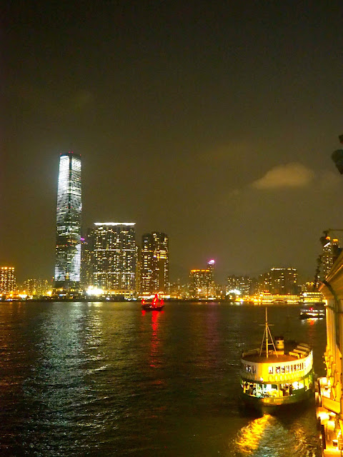 View of Star Ferry and ICC across Victoria Harbour at night, Hong Kong