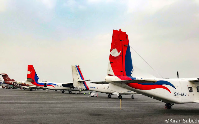 Nepal airlines y12e 9n-aku with Dhc-6 9n abt and ma 60 9n akr