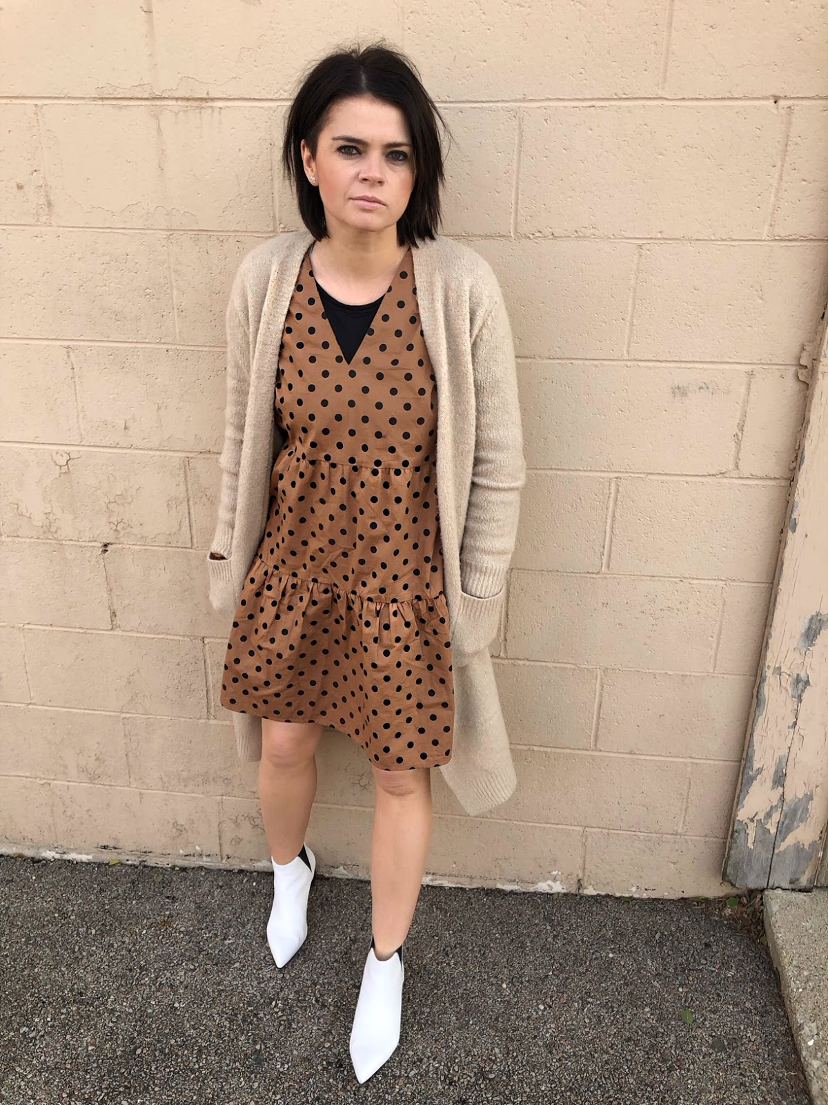 A camel tone dress with black polka dots