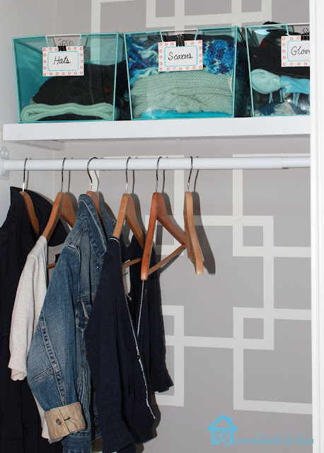 wooden hangers on closet makeover with geometric design