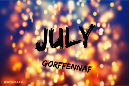 'July - Gorffennaf' against an artsy sparkly/firey background