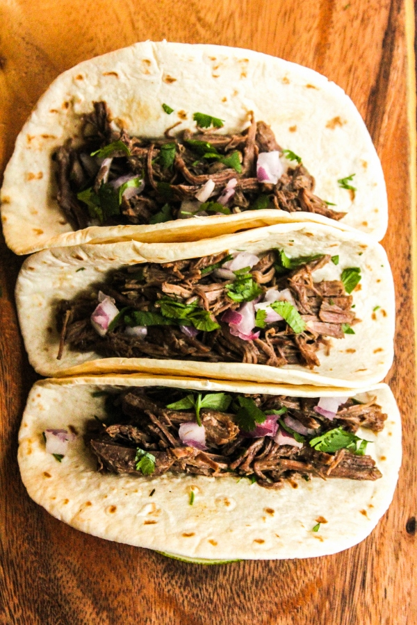 This Pressure Cooker Beef Carnitas Tacos recipe is juicy, flavorful and delicious, and so quick and easy to make!