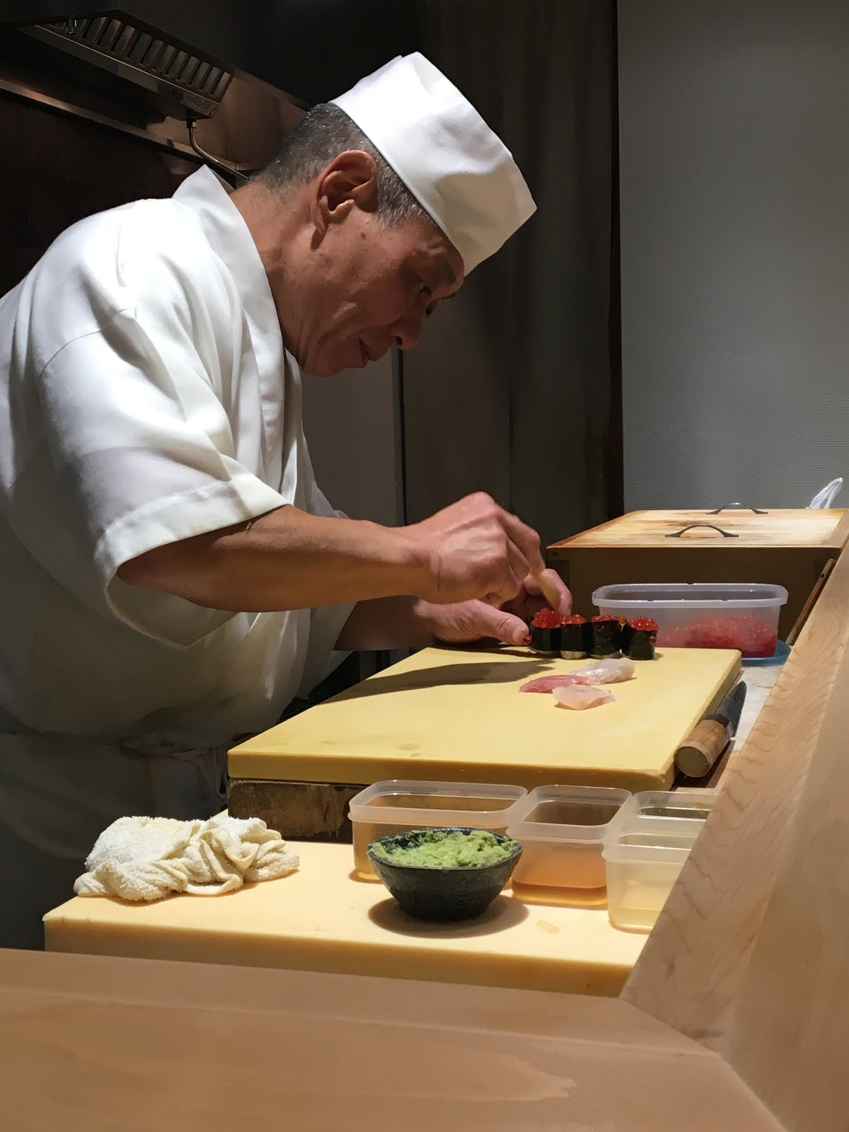 Sushi chef yasuda in action making sushi