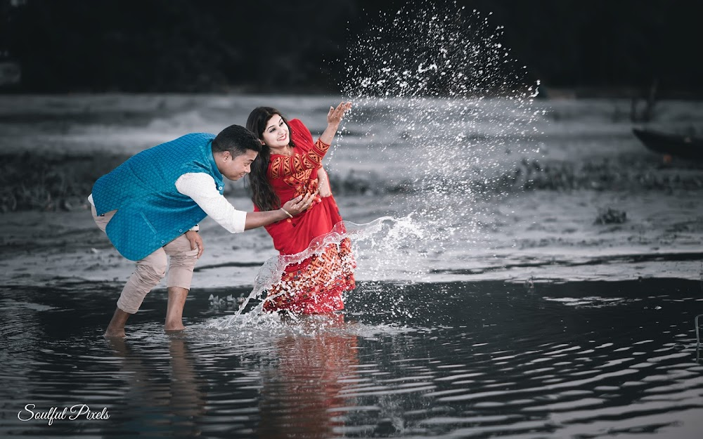 Couple Playing With Water