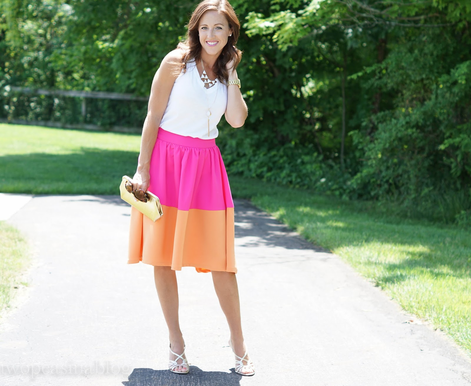 292d0727a512 How fun is this midi skirt from Mindy Mae's Market? It immediately caught  my eye when I saw it on their website. The slight hi-low cut and bright  color ...