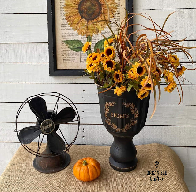 Photo of a DIY black urn with fall decor
