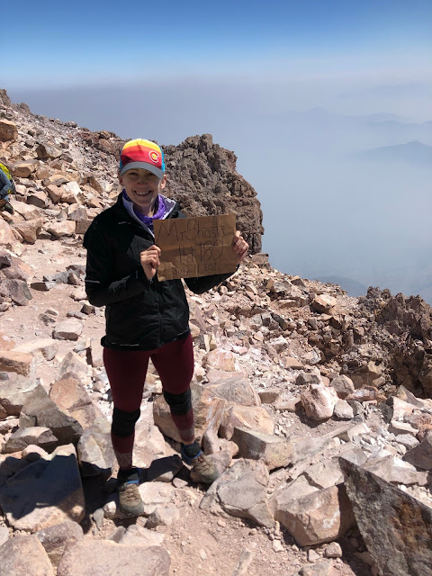 woman on the top of a 14,000 foot tall mountain