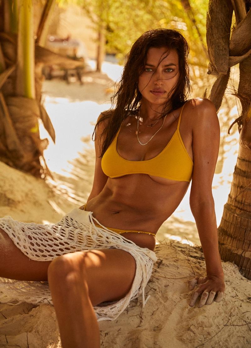 Rocking a bikini, Irina Shayk fronts REVOLVE x Tropic of C Swim collection. Photo: David Roemer