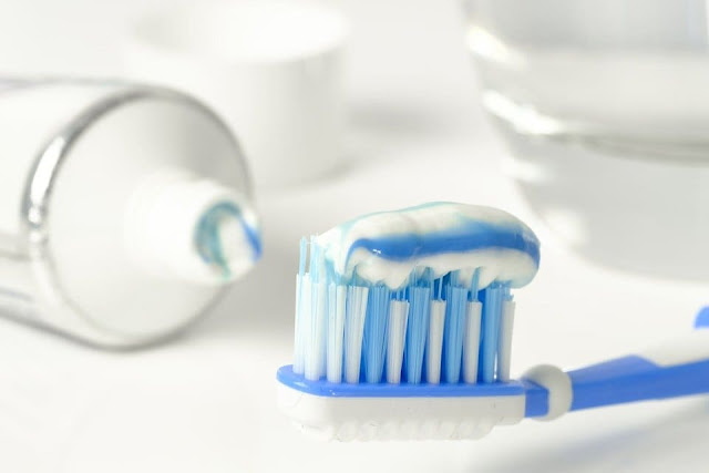 whitening toothpaste on a toothbrush