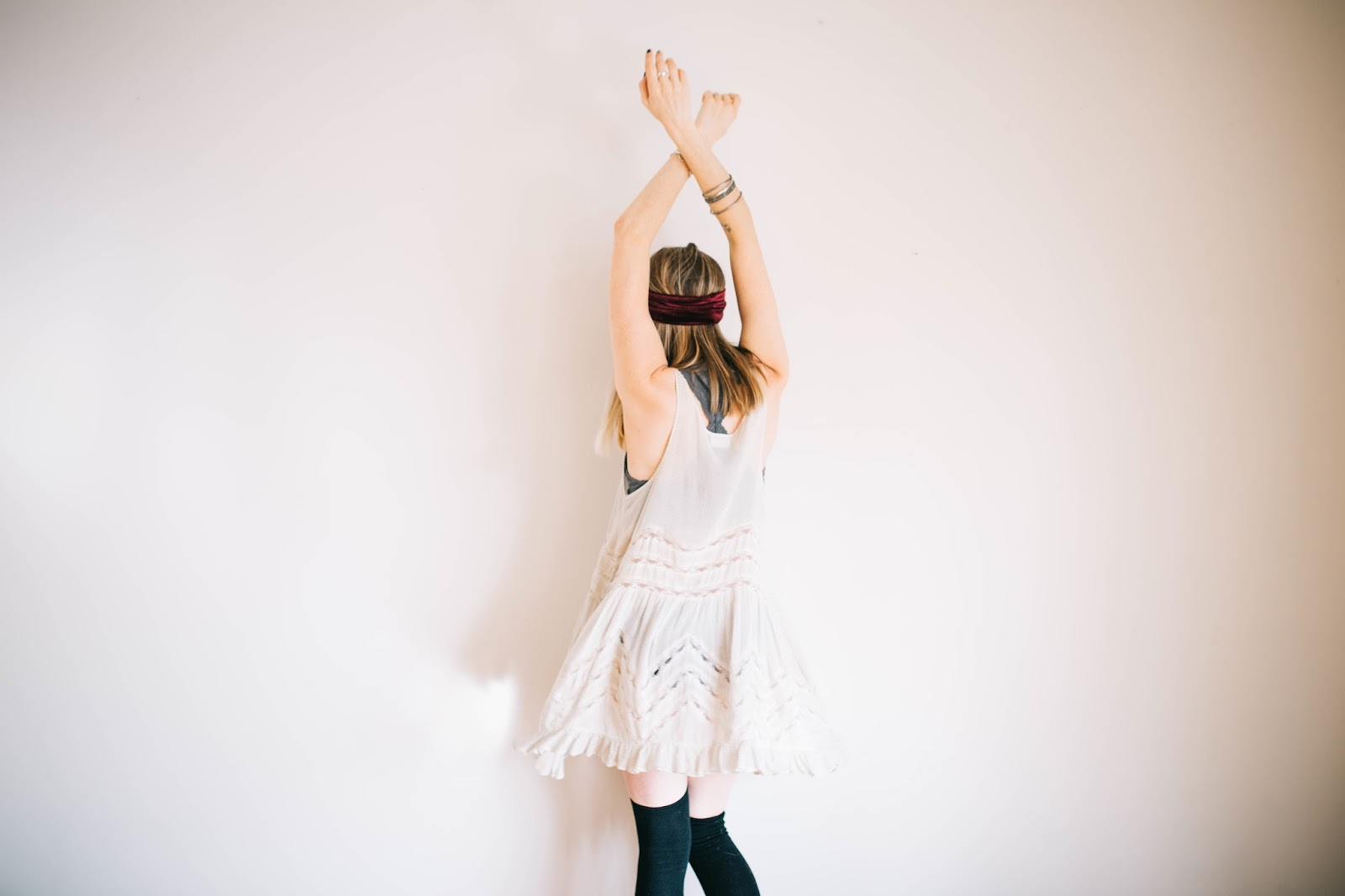 Woman with hands in the air - spring clean your beauty routine & win Boots giftcard