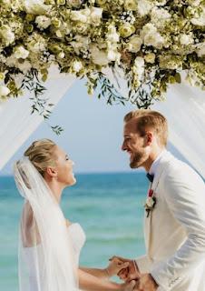 Katie Goodland with her husband on their wedding dress