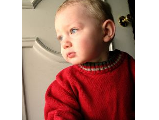 Image: Eyes are the window to the soul - Boy looking out the front door. Photo credit: Randa Clay on FreeImages
