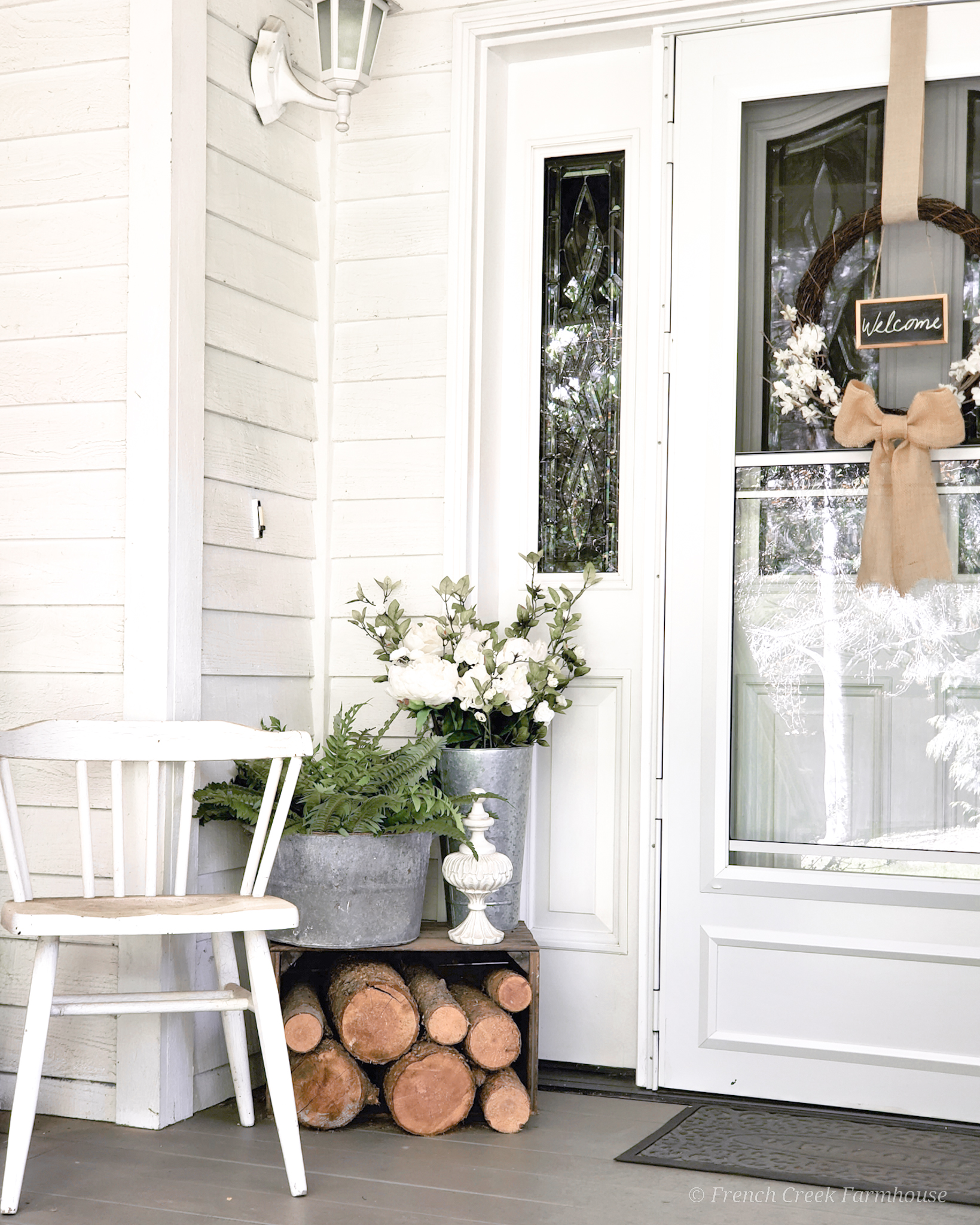 Classic farmhouse touches with loads of blooms are great inspiration for spring decor