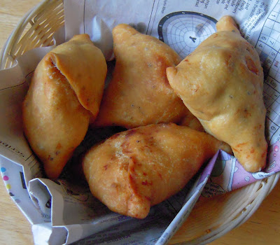 Samosa is a pyramid-shaped pastry stuffed with a savoury potatoes peas filling. In this post I am sharing a detailed samosa recipe.