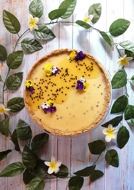 Passionfruit Tart, passionfruit, tart, summer, dessert, tart recipe, passionfruit recipe, passionfruit tart recipe, food, food blogger, food pictures, food photography, dessert recipe, dessert pictures, tart pictures, passionfruit pictures, edible flowers, food flatlay, dessert flatlay, food blogger, spicy fusion kitchen, sweet, pinterest desserts, flowers, step by step pictures, step by step recipe, woolworths, kenwood, nestle, digestive biscuits, granadilla, botswana, food blog, granadilla pictures, granadilla recipe, granadilla pulp