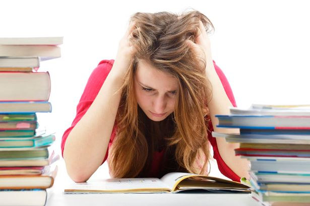 Young-girl-unhappy-about-homework.jpg