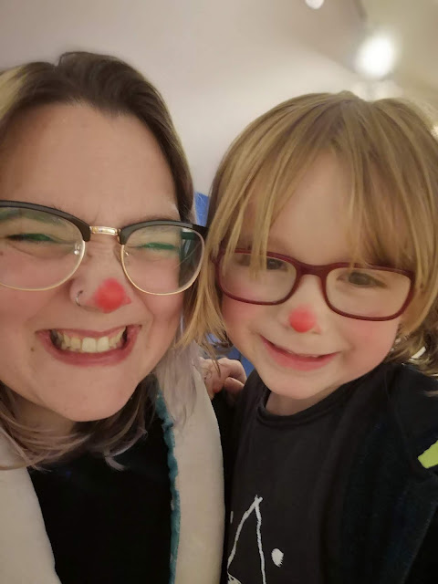 Mom and Son with red noses ready to watch Rudolph