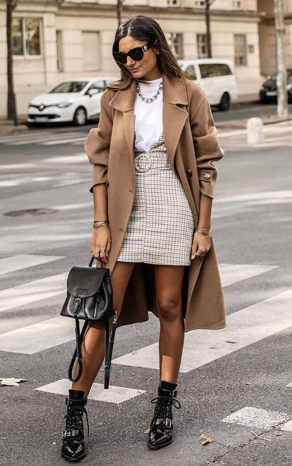 fashionable fall outfit / boots + black backpack + plaid sundress + brown coat + tee