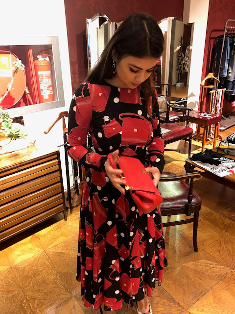 Kelly Fountain in Dolce and Gabbana dress in Milan Italy showroom during Milan Fashion Week
