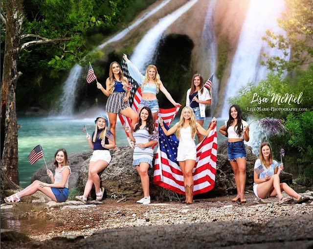 Group of high school girls with flags by Turner Falls