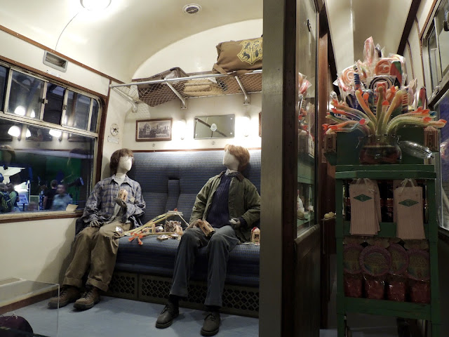 Harry and Ron in the train carriage, the sweets trolly nearby