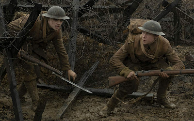 "Lance Corporal Blake (Dean-Charles Chapman) and Lance Corporal Schofield (George MacKay) slip under barbed wire and walk into enemy territory in ""no man's land"" in the WWI drama film ""1917."""