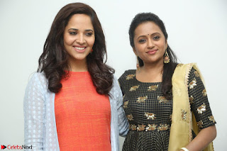 Actress Suma in Black Salwar Suit and Anusuya in orange Dress at winner movie press meet part 1 February 2017 (9).JPG