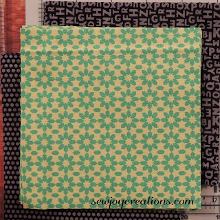 two complimentary background fabrics