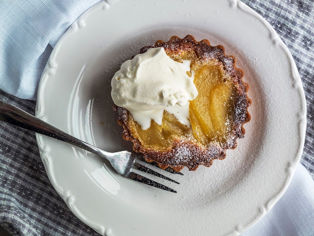 Pear and Almond Mini Tart with a dollop of cream.