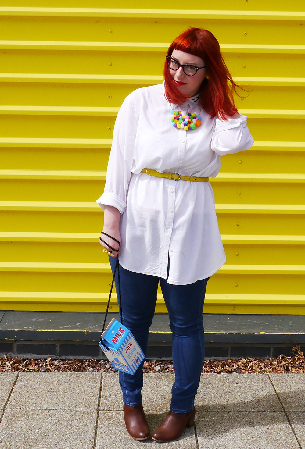 Style dby Helen, Scottish Blogger, red hair, ginger style, cat eye glasses, Dundee blogger, Dundee style, Monki shirt, simple white shirt, blue jeans style, topshop jean, yellow belt. skinny belt, belted shirt, milk bag, novelty bag, Skinnydip London bag, Zara brown boots, brown boots, chelsea boots, pom pom necklace, statement necklace, DIY necklace, handmade style, colourful style, colourful outfit, colourful street style, bright ootd, bonnie bling, bonnie bling name ring, yellow ring