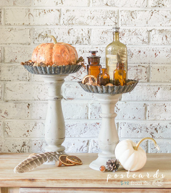 salvaged pans and candlesticks repurposed into pedestals