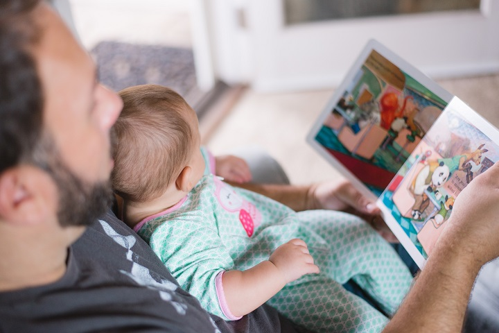 Dad reading book with baby