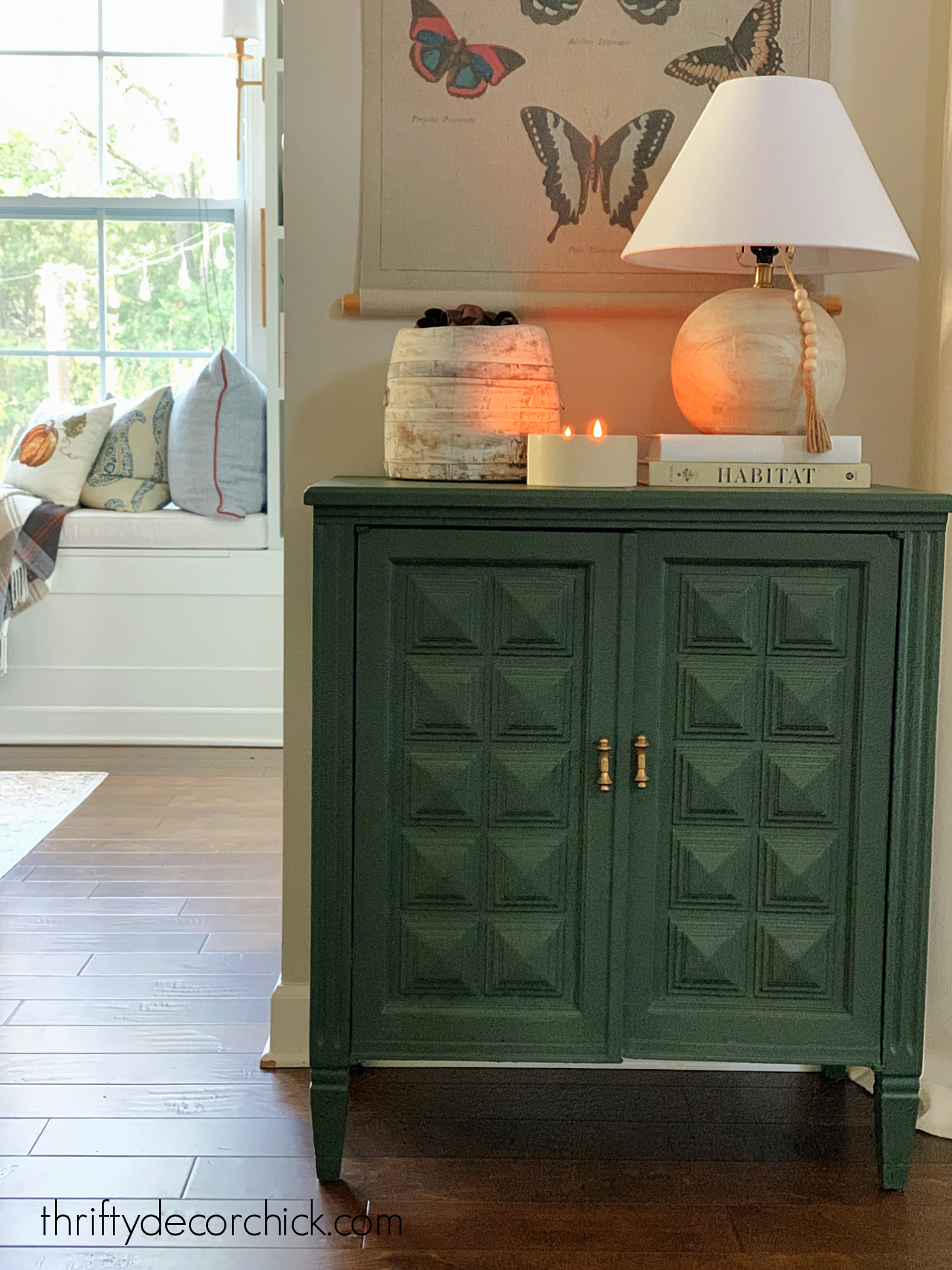 Dark green cabinet with decor