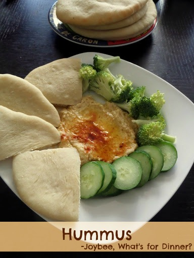 Hummus:  A creamy dip or spread made from chickpeas, tahini, lemon juice and olive oil.  Great with vegetables or pita.