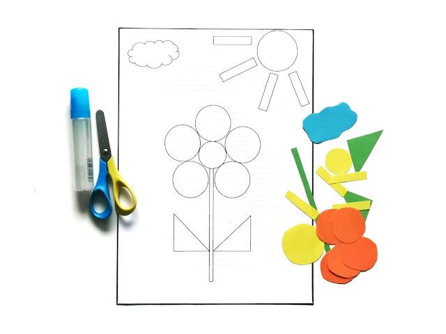 na zdjęciu kartka a4 z nadrukowaną ilustracją kwaiatka, słońca i chmury w geometrycznych kształtach, obok leżą kolorowe kształty do naklejenia