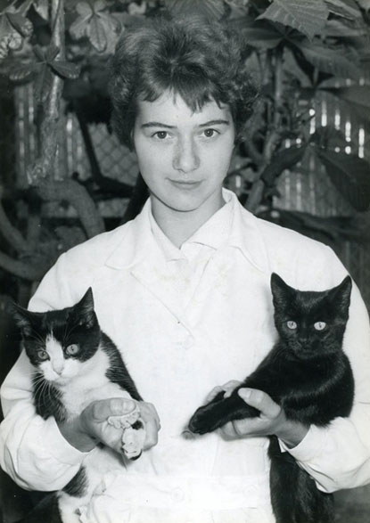 A Cats Protection volunteer with two cats