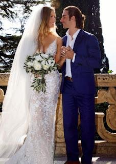 Birgen Anika Hartman in wedding dress with her husband Brandon