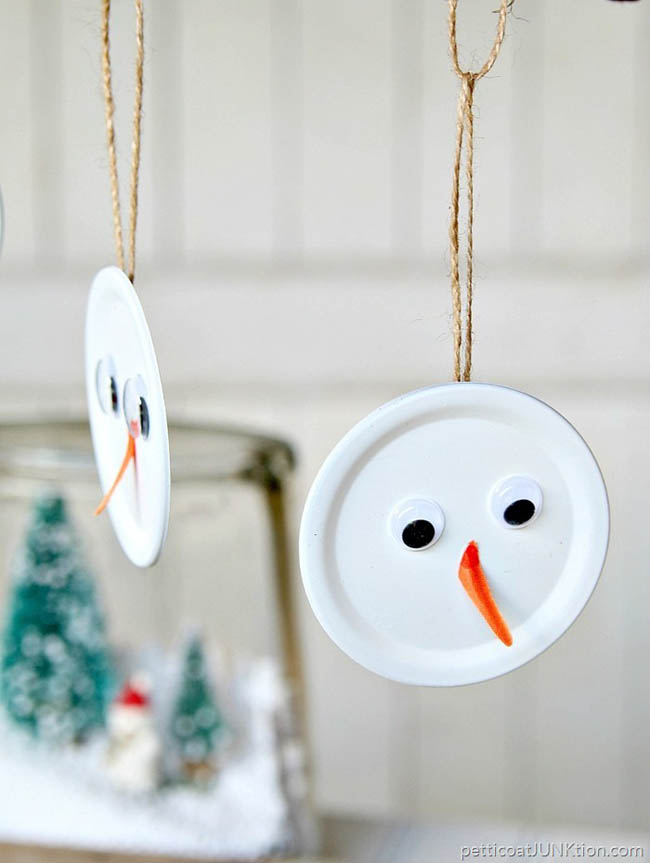 mason jar lids got turned into snowmans