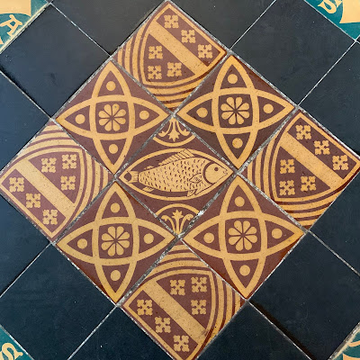 fish tiles at Gloucester Cathedral